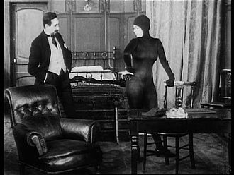"Les Vampires - Juan-José Moréno (Fernand Herrmann) confronts Irma Vep in ""Hypnotic Eyes""."