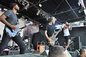 Letlive - letlive. performing at 2014's Summerblast Festival in Trier, Germany. (LtR: Jean Nascimento, Ryan Johnson, Jason Butler. Obscured: Loniel Robinson, Jeff Sahyoun.)