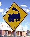 Level crossing sign in Bomen, NSW, Australia.jpg