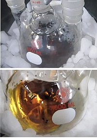 Photos of two solutions in round-bottom flasks surrounded by dry ice; one solution is dark blue, the other golden.