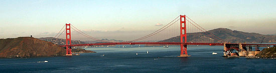 Golden Gate Bridge, with its approach arch over Fort Point at the San Francisco terminus (right). Behind the arch is Angel Island, and to the left of that, Tiburon, California, mostly obscuring the East Bay hills.