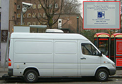 Closed-circuit cameras and vans police the zone, capturing live video. Vans can be identified by a sticker on the back door (inset).
