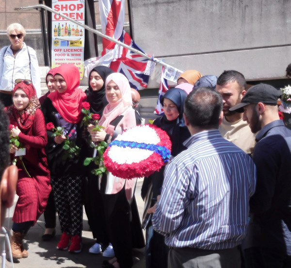 Muslims offering peace at London Bridge after the 2017 terrorist attack. London Bridge Muslim DSCN0197.jpg