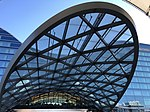 Looking up at Denver Airport Station entrance canopy with hotel in background.jpg