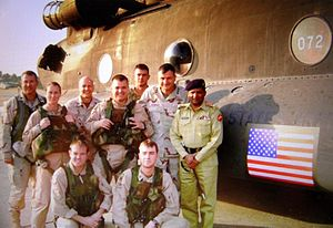 Karl Eikenberry - With US Army Aviation CH-47 crew and Pakistan Army Liaison Officer in Pakistan when commanding the US-led coalition Kashmir earthquake disaster relief operations, October 2005.