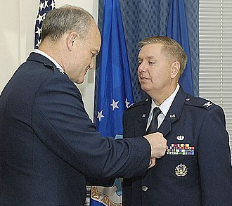 Jack L. Rives - Lt. Gen. Rives pins the Meritorious Service Medal on Col. Lindsey Graham (United States Senator, South Carolina), April 2009.