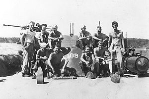 Lt. John F. Kennedy with other crewmen on board USS PT-109.jpg