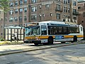 MBTA route 65 bus passing Fenway station, August 2016.JPG