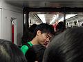 MTR people 2 youngman phone.jpg