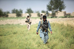 Kilo Company, 3rd Battalion, 8th Marine Regiment, partnered with Afghan National Police, patrol through Garmsir District, June 1, 2012