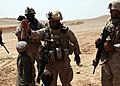 Marines high-five with an Afghan child (5000805511).jpg