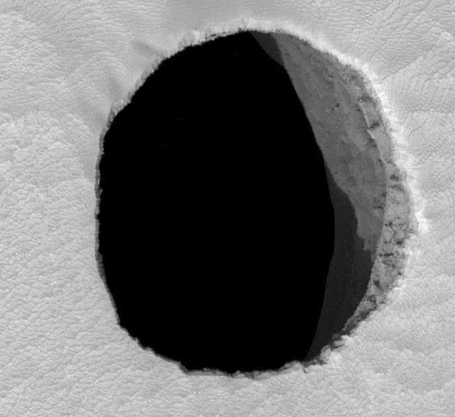 Dark pit on the Arsia Mons volcano - this one is at least 178 meters deep