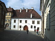 Matthias Corvinus Alley, facing the birthplace of the eponymous King of Hungary