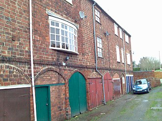 Joseph Wilkes - These buildings in Measham are constructed with Joseph Wilkes' double sized 'Jumb' or 'Gob' bricks and were originally part of his brickyard, The ground floor sheds were originally the brick-drying sheds, whilst the upper floors were used as weaving sheds.