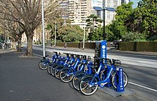 Row of blue rental bicycles