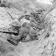 Men of 'D' Company, 1st Battalion, The Green Howards occupy a captured German communications trench during the offensive at Anzio, Italy, 22 May 1944. NA15297