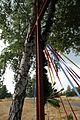 Metalowy krzyż przydrożny ozdobiony wstążkami i girlandą ze sztucznego świerku - Stefanowice - 000772c.jpg