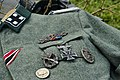 Military equipment replicas for WW2 re-enactment in Fort Harrison State Park, Lawrence, Indiana, US September 2008. German Waffen SS uniform tunic Awards Decorations 01.jpg