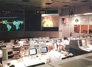 Pneumatic tube - NASA Mission Control Center during the Apollo 13 mission. Note pneumatic tube canisters in console to the right.