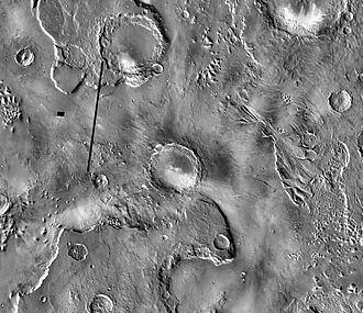 Mojave (crater) - THEMIS daytime infrared image mosaic showing Mojave (center) and its surroundings. The outflow channel Tiu Valles snakes through the image south-north to the right of Mojave.