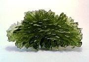 Moldavite, a natural glass formed by meteorite impact, from Besednice, Bohemia