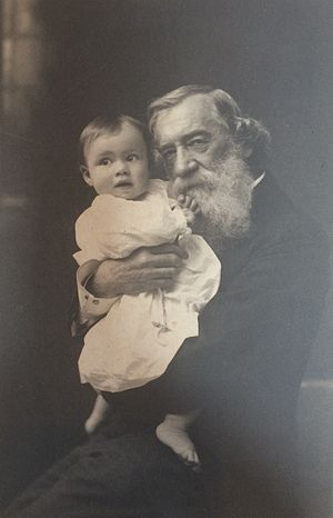 Moncure D. Conway - Photo taken c. 1884 of Moncure D. Conway holding a baby.