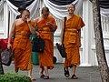 Monks in Street - Bangkok - Thailand (34712727055).jpg