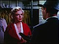 Monroe frowns at Cotten from the trailer of Niagra 1.jpg