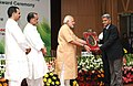 Narendra Modi presenting the NASI-ICAR Award for innovation and research on Farm Implements 2013 to the University of Agricultural Sciences, Bangalore, at the 86th Foundation Day of ICAR and ICAR award presentation ceremony.jpg