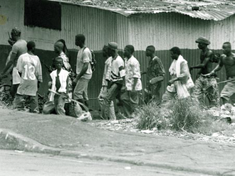 First Liberian Civil War - NPFL fighters search for ULIMO militants in Monrovia.