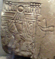 Close-up of a limestone relief depicting Nefertiti smiting a female captive on a royal barge. On display at the Museum of Fine Arts, Boston.