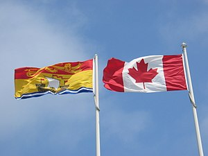 Flag of New Brunswick - The New Brunswick flag (left) flying alongside the Canadian flag in Grand Bay–Westfield.