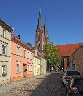 Neuruppin - Street with Holy Trinity Church