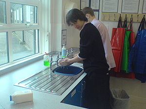 Oathall Community College - A year 11 student washes his hands in preparation for a cooking session in the new food technology department