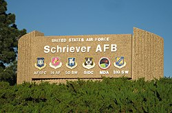 Sign with emblems of units based at Schriever AFB