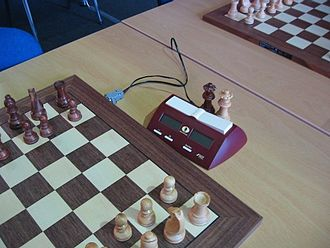Chess clock - Digital chess clock connected to a board that automatically senses when moves have been made