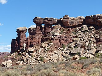 Organ Rock Formation - Towers of red Organ Rock capped with White Rim Sandstone in Shafer Canyon in Canyonlands National Park