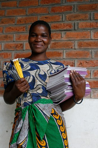 HIV/AIDS in Malawi - Partners in Health worker with disease treatment literature in Malawi