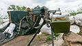 PK machine gun at Russia-backed rebel position near the division line with Ukrainian army near Dokuchaevsk, eastern Ukraine, Friday, June 5, 2015.jpg