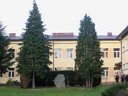 School in Szebnie with the camp memorial stone
