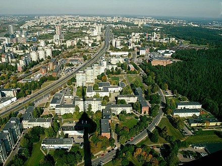 The majority of Vilnius inhabitants nowadays live on the right bank of the Neris in neighborhoods, constructed during the last half of a century from the late 1960s and that are still being built in the 2010s. Panorama of North Western part of Vilnius.jpg