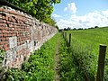 Path runs along the rear wall of Easterton Manor Farm - Easterton, Wiltshire - geograph-4000875.jpg