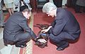 Photograph of President William Jefferson Clinton and President Jacques Chirac of France Petting Buddy the Dog- 02-19-1999 (6461540955) (cropped).jpg