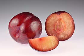 Plums African Rose - whole, halved and slice.jpg