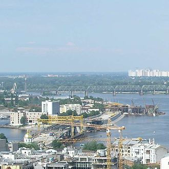 Kiev River Port - Panoramic view of Podil with Harbor entrance seen.
