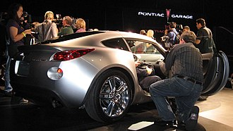New York International Auto Show - Journalists crowd around the Pontiac Solstice coupe during its unveiling