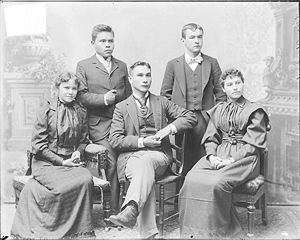 Cultural assimilation of Native Americans - Portrait of Marsdin, Non-Native Man, and Group of Students from the Alaska region.
