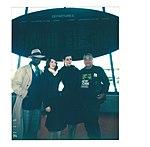 Portrait with costumed visitors with OHNY volunteer inside JFK flight center.jpg