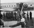Prime Minister Winston Churchill, surrounded by cameramen and dignitaries, leaves the airplane which brought him to... - NARA - 198870.tif
