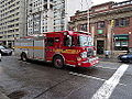 Pumper 323 at the intersection of Sherbourne and Bloor, 2014 12 17 (1) (15861830067).jpg